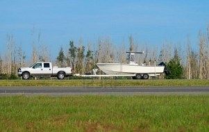 1779493-truck-towing-boat.jpg