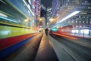 7412023-fast-moving-bus-lights-blurred-over-modern-city-background.jpg