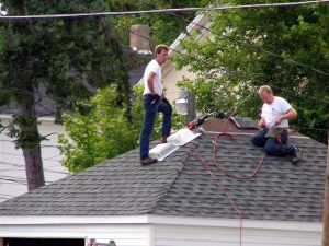 159890_men_on_roof.jpg