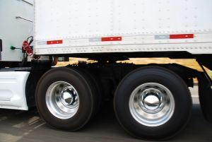 close up photo of the wheels on a semi truck
