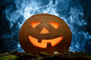 10640612-halloween-pumpkin-on-leafs-with-blue-smoke.jpg