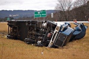 2940620-a-tractor-trailer-on-its-side-in-the-median-after-a-roll-over-accident.jpg