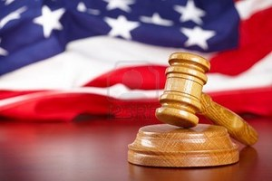 8887440-judges-wooden-gavel-with-usa-flag-in-the-background.jpg